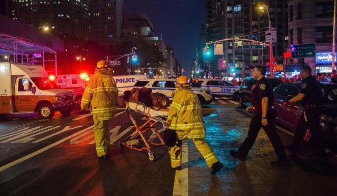 First responders work near the scene of an explosion in Manhattan's Chelsea neighborhood on Sept. 17 in New York. Although the pressure cooker bomb that wounded over two dozen people on the street went off in front of an apartment building for the blind, none of the building's residents were hurt in the blast. (Associated Press)